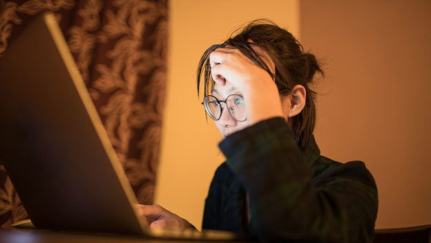 Young female student sitting at her computer table