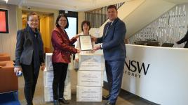 Members of SCUT hand deliver alumni donations to Mr Jon Paparsenos, Vice-President UNSW Philanthropy